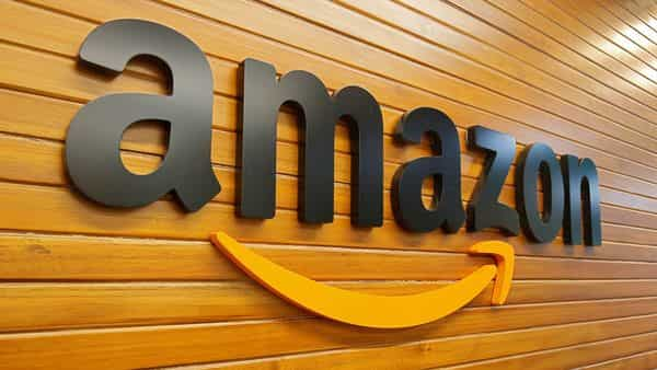 FILE PHOTO: The logo of Amazon is pictured inside the company's office in Bengaluru, India (REUTERS)