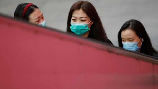 Women wear face masks amid the coronavirus disease (COVID-19) outbreak in Beijing. (REUTERS)