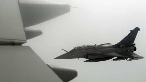 FILE PHOTO: A French Rafale fighter jet demonstrates the interception of a Belgian air force transport plane as they fly over France (REUTERS)