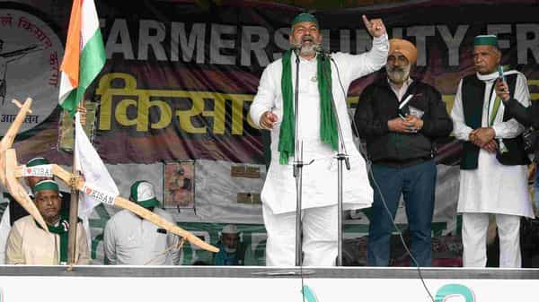 BKU leader Rakesh Tikait addresses the farmers during an ongoing protest against the new farm laws, at the Delhi-Ghazipur border in New Delhi on Thursday. (ANI Photo)