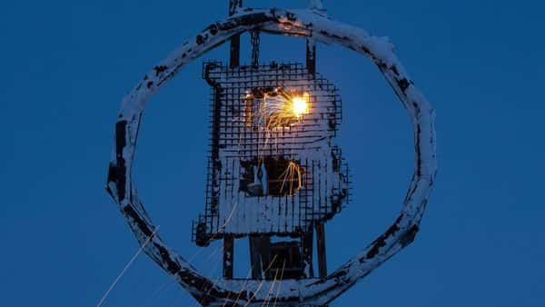 Sparks fly during welding as a bitcoin sculpture made from scrap metal is installed  (Bloomberg)