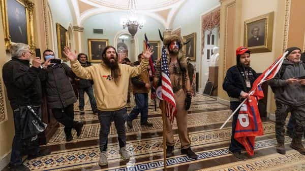 In this Jan. 6, 2021 file photo, supporters of President Donald Trump are confronted by U.S. Capitol Police officers outside the Senate Chamber inside the Capitol in Washington. (AP)