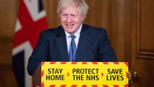 Britain's Prime Minister Boris Johnson smiles during a virtual press conference on the novel coronavirus. (AFP)