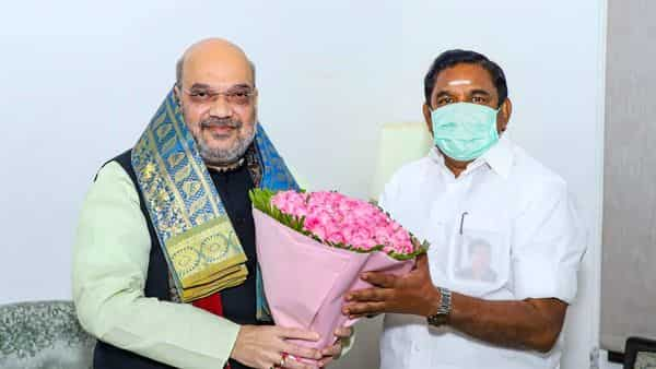 Union Minister Amit Shah is greeted by Tamil Nadu Chief Minister K Palaniswami during a meeting at his residence, in New Delhi. (PTI)