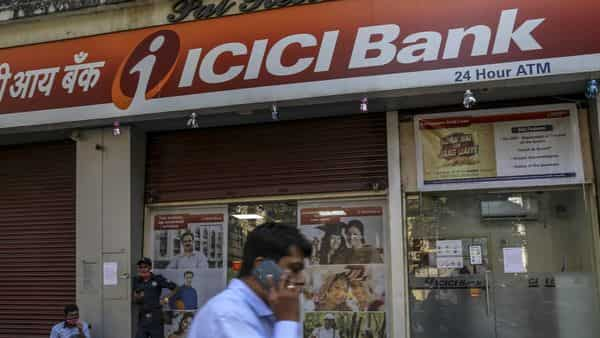 A pedestrian walks past an ICICI Bank Ltd. branch in Mumbai, India, on Friday, Dec. 4, 2020. Home sales in India's commercial capital jumped to an eight year high in October, according to data from Knight Frank, marking an abrupt turnaround for a market that's spent three years in the doldrums after a�prolonged shadow banking crisis�strangled access to credit. Photographer: Dhiraj Singh/Bloomberg (Bloomberg)