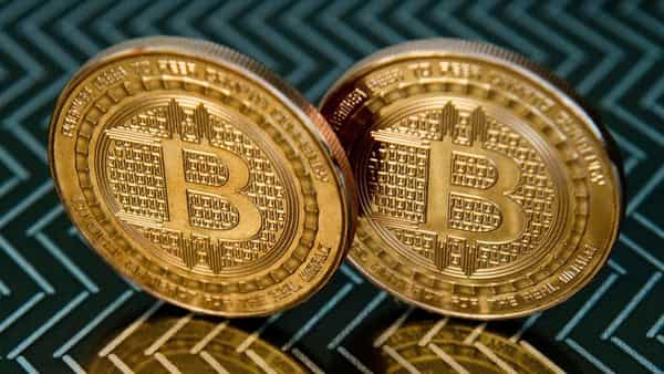 Analysts have pointed to $40,000 as the key level that Bitcoin needs to surpass in order to draw fresh money from investors riding cryptocurrency momentum (AFP)