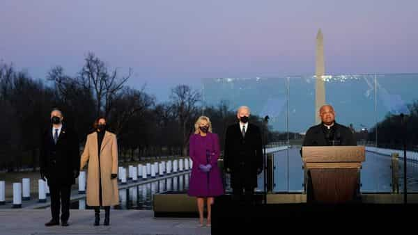 Washington : President-elect Joe Biden and his wife Jill, along with Vice President-elect Kamala Harris and her husband Doug Emhoff, listen as Cardinal Wilton Gregory, Archbishop of Washington, delivers the invocation during a COVID-19 memorial, with lights placed around the Lincoln Memorial Reflecting Pool, (AP)