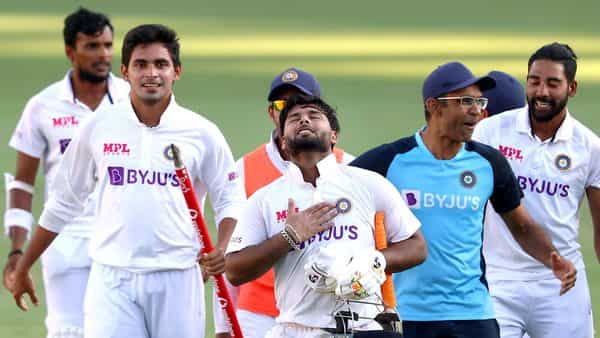 Brisbane: Indian players celebrate after defeating Australia by three wickets on the final day of the fourth cricket test match at the Gabba, (PTI)