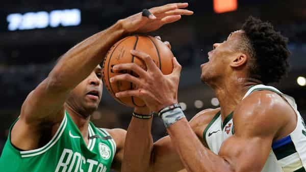 Boston Celtics' Al Horford knocks the ball from Milwaukee Bucks' Giannis Antetokounmpo during the first half of Game 2 of a second round NBA basketball playoff series Tuesday, April 30, 2019, in Milwaukee. (AP Photo/Morry Gash)