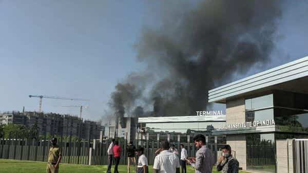 Smoke comes out of a building of Serum Institute after fire broke out in its Manjri premise in Pune. (Shankar Narayan/HT)