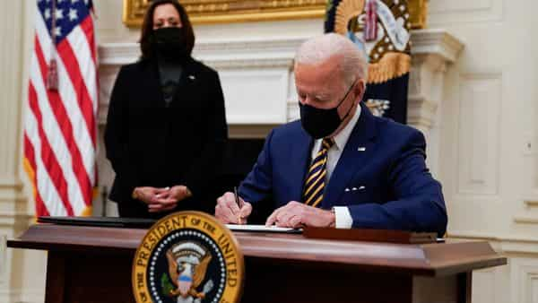 In first days, Joe Biden flashes action as deep problems loom