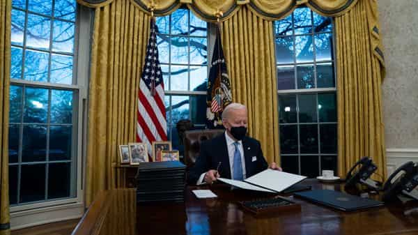 President Joe Biden signs a series of executive orders in the Oval Office (AP)