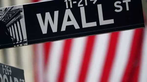 FILE PHOTO: A Wall Street sign is pictured outside the New York Stock Exchange. (REUTERS)