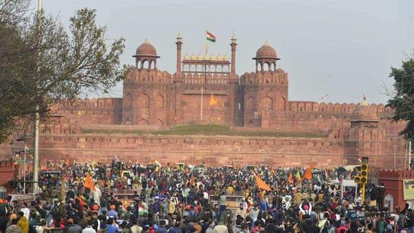 Farmers gather at Red Fort during their tractor parade on Republic Day, (PTI)