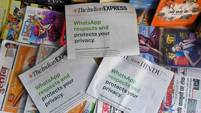 An advertisement from WhatsApp is seen in a newspaper at a stall in New Delhi on January 13, 2021. (Photo by Sajjad HUSSAIN / AFP)
