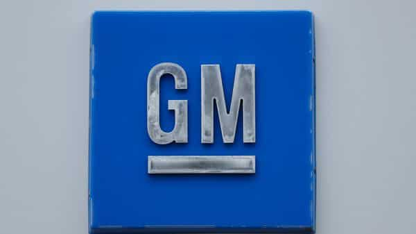 FILE - In this Jan. 27, 2020 file photo, a GM logo is shown at the General Motors Detroit-Hamtramck Assembly plant in Hamtramck, Mich. General Motors, the Detroit automaker making an aggressive push into electric vehicles, is establishing a goal of becoming carbon neutral in both its global products and its operations by 2040.  (AP Photo/Paul Sancya, File) (AP)