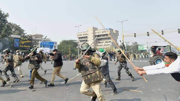 Police and protesting farmers clash during the latter's 'tractor march' on Republic Day in New Delhi. (PTI)