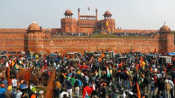 FILE PHOTO: Farmers gather in front of the historic Red Fort during a protest against farm laws introduced by the government, in Delhi, India, January 26, 2021. REUTERS/Adnan Abidi/File Photo (REUTERS)