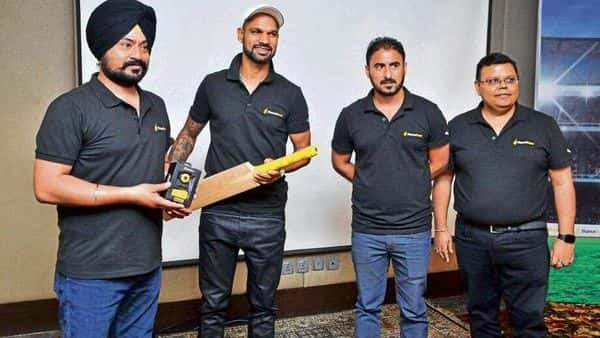 StanceBeam founder Arminder Thind (left) with opener Shikhar Dhawan holding a bat with an IoT device. Also seen are co-founder Ishwinderpal Singh (second from right) and Dinesh Prasad, who is an adviser to the firm