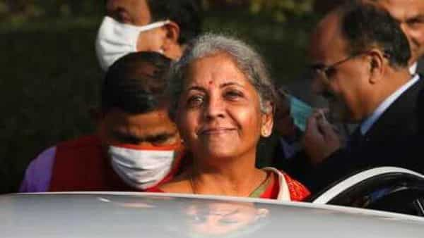 Finance Minister Nirmala Sitharaman, centre, leaves finance ministry for the parliament house to present annual federal budget, in New Delhi, Monday (AP)
