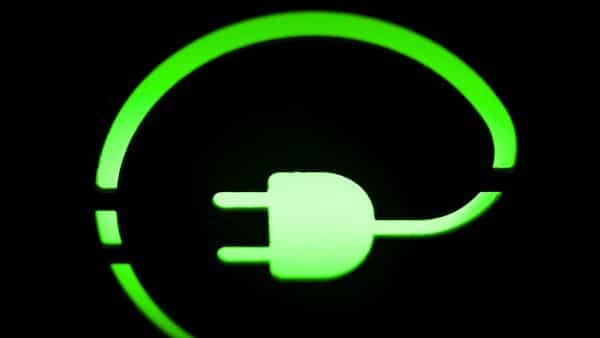 File Photo: An electric automobile charging plug symbol  (Bloomberg)
