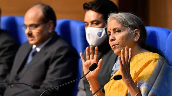 Union Finance Minister Nirmala Sitharaman, MoS Finance Anurag Thakur and  Finance Secretary Ajay Bhushan Pandey during the post-budget press conference, at National Media Centre in New Delhi (PTI)