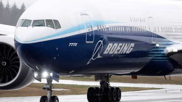 The bonuses are expected to be distributed next month and will vary depending on the department, Boeing said (REUTERS)