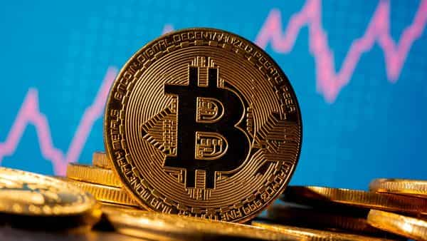 Despite doubters on Wall Street, the unceasing buzz over Bitcoin is leading more banks to develop cryptocurrency products for clients. (REUTERS)