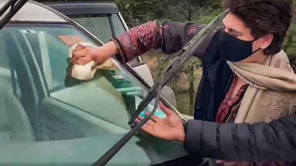 **EDS: VIDEO GRAB** New Delhi-Rampur: Congress General Secretary Priyanka Gandhi Vadra cleans the windshield of her vehicle while enroute to UP's Rampur district to visit family members of Navreet Singh, who died after his tractor overturned during the farmers rally on Republic Day, Thursday, Feb. 4, 2021. (PTI Photo)(PTI02_04_2021_000031A) (PTI)