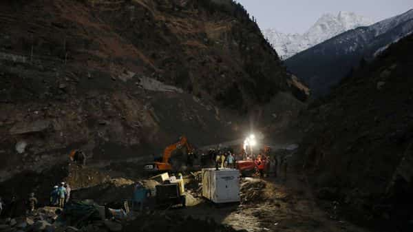 Members of rescue team work during a rescue and relief operation at the site of a destroyed hydroelectric power station after a flash flood swept down a mountain valley destroying dams and bridges, in Raini village in the northern state of Uttarakhand (REUTERS)