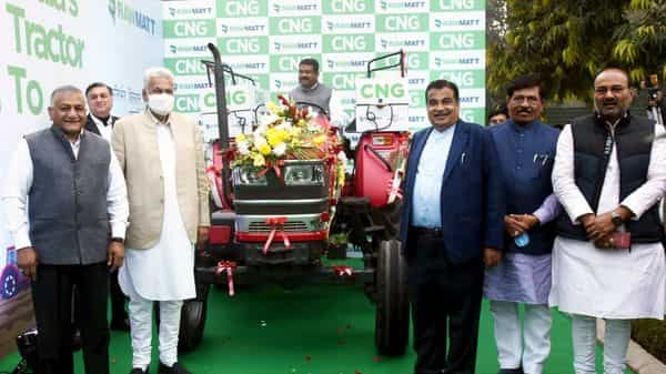 Union Minister for Road Transport & Highways Nitin Gadkari and the Union petroleum minister Dharmendra Pradhan launch the CNG tractor (ANI Photo)