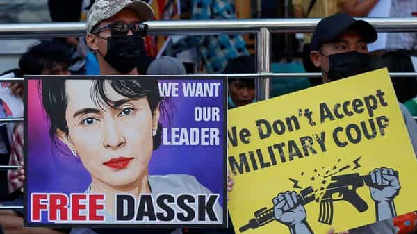 Demonstrators hold signs during a protest against the military coup, in Yangon, Myanmar, February 14, 2021 (Photo: Reuters)