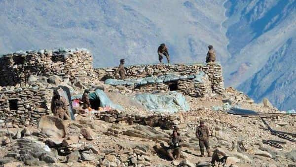 This photograph provided by the Indian Army, shows Chinese troops dismantling their bunkers at Pangong Tso region, in Ladakh along the India-China border. (AP)