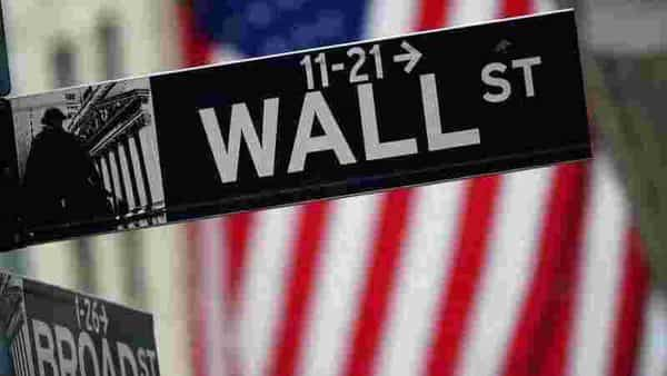 Wall St slips on surprise rise in jobless claims, tech slide, Dow drops 260 pts - Mint