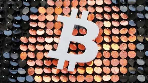FILE PHOTO: Speculators, corporate treasurers and institutional investors are thought to have stoked Bitcoin's volatile ascent (REUTERS)