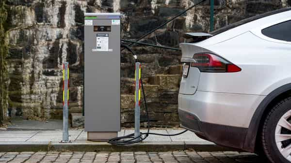 A plug-in electric vehicle charing point in Stavanger, Norway, on Wednesday, Feb. 17, 2021. The Norwegian krone has become the best performing G10 currency in the year to date. Photographer: Carina Johansen/Bloomberg (Bloomberg)