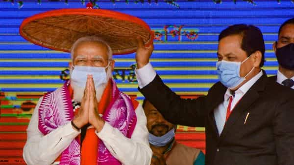 Prime Minister Narendra Modi being felicitated with a 'Jaapi' (traditional Assamese hat) by Assam Chief Minister Sarbananda Sonowal during the foundation stone laying ceremony of various projects at Silapathar, in Dhemaji district (PTI)