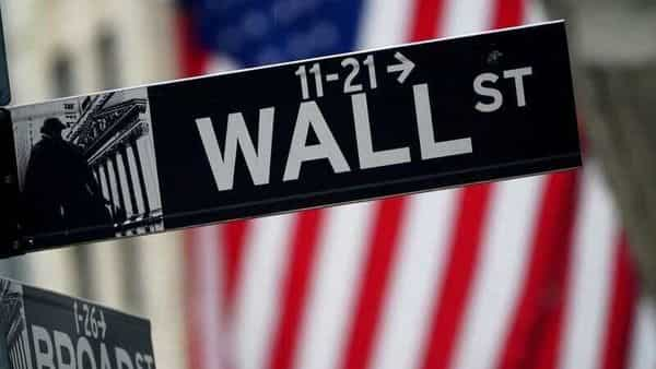 FILE PHOTO: A Wall Street sign outside the New York Stock Exchange in New York City, New York, U.S., October 2, 2020. REUTERS/Carlo Allegri (REUTERS)