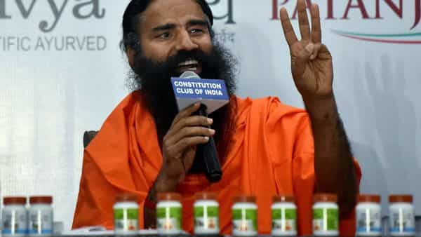 Yog Guru Ramdev addresses media during the release of the 'first evidence-based medicine for COVID19 by Patanjali', at Constitution Club of India in New Delhi on Friday. (ANI Photo)