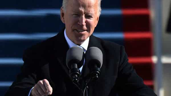 (FILES) In this file photo taken on January 20, 2021 US President Joe Biden delivers his inauguration speech on January 20, 2021, at the US Capitol in Washington, DC. - The US death toll from Covid-19 is approaching a grim milestone: Half a million people in this country dead from the coronavirus. (Photo by ANDREW CABALLERO-REYNOLDS / AFP) (AFP)