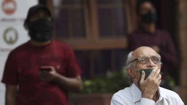 Mumbai: Pedestrians watch stock prices on a digital screen.  (PTI)