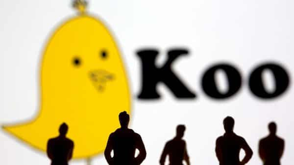 Small toy figures are seen in front of displayed Koo app logo in this illustration taken, (REUTERS)