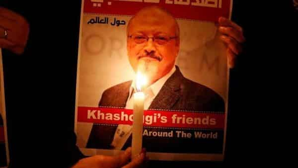 A demonstrator holds a poster with a picture of Saudi journalist Jamal Khashoggi outside the Saudi Arabia consulate in Istanbul, Turkey. (REUTERS)
