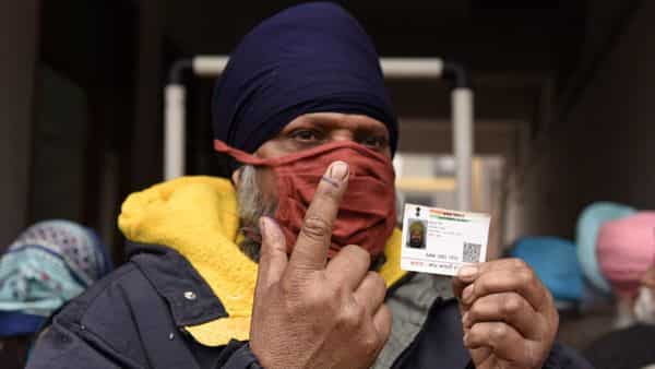 Voters show their inked fingers  (AFP)