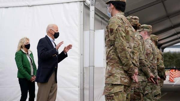 President Joe Biden and first lady Jill Biden meet with troops at a FEMA COVID-19 mass vaccination site at NRG Stadium, Friday, Feb. 26, 2021, in Houston. AP/PTI Photo(AP02_27_2021_000008B) (AP)