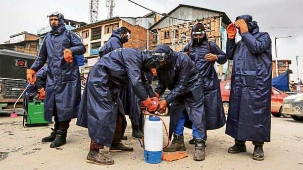 Municipal workers in Srinagar in early March, 2020. By 3 March, 2020, the fact that this was going to be a fast-spreading virus became clear. (Photo: Reuters)