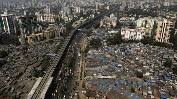 Slums and high-rise buildings are seen in Mumbai (REUTERS)