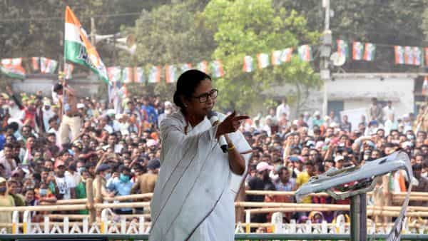 West Bengal Chief Minister Mamata Banerjee addresses during a TMC rally, in Hoogly. (ANI Photo)