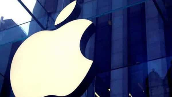 FILE PHOTO: The Apple Inc logo is seen hanging at the entrance to the Apple store  (REUTERS)