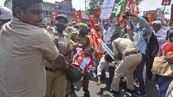 Visakhapatnam: Police personnel detain the activists of Left party, Vizag steel plant workers union and various trade unions while trying to block the National Highway 16 during a protest against the privatization of the Vizag steel plant, in Visakhapatnam. (PTI)